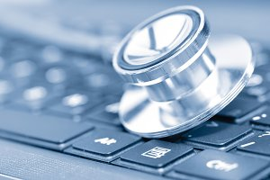 closeup if a stethoscope on a computer keyboard