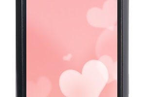 touch screen phone with valentine background on it. Screen is cu