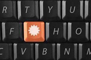sun key on black keyboard