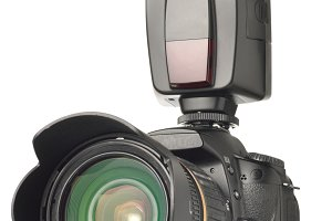 photo camera with an external flash installed