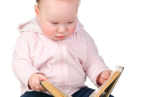 baby is reading a book