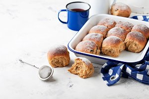 Fresh whole grain sweet buns with raisins