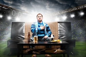 soccer fan on sofa