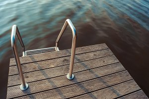 Metal ladder in pool