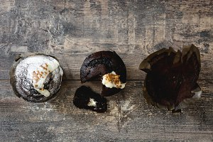 Muffins on wooden background