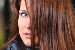 close up portrait of a beautiful young brown haired woman
