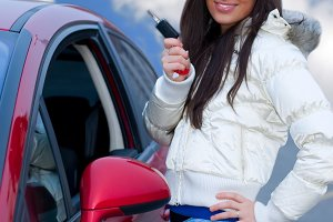 young woman and her keys to auto