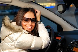 young beautiful woman in a car