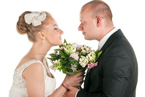 wedding couple are holding bridal bouquet
