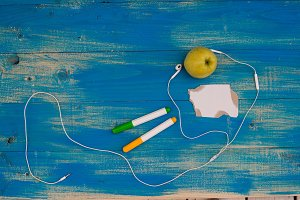 Apple, headphones, pens