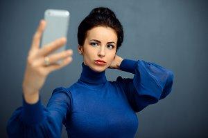 girl makes self phone