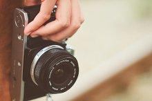Hand holding film camera
