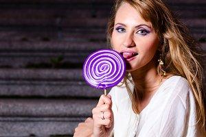 fashionable woman with huge lollipop