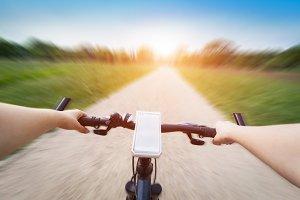 Riding a bike.