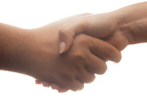 Handshake on white background.