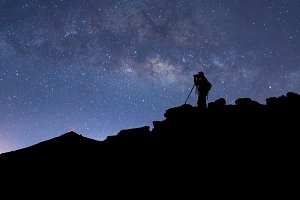 Photographer, stars and Milky Way