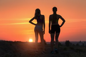 silhouette of young sporty girls
