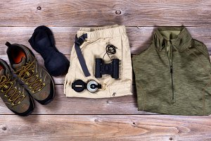 Clothing and Hiking Gear on wood