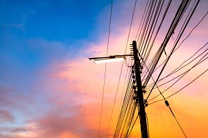 electricity poles at sunset
