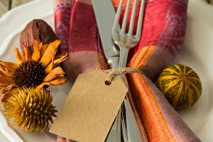 Thanksgiving table setting on rustic wood background