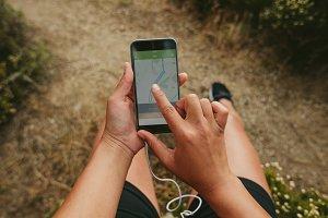 Female runner using a fitness app