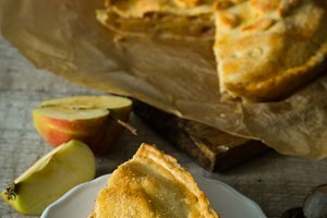 Apple pie on rustic wood background