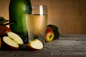 Apple cider in glass bottle with water drops