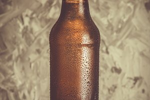 Beer in bottle with ice drops