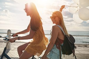 Happy young women on bike