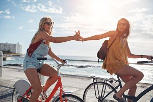Female friends riding cycles