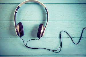 Headphones on blue wooden