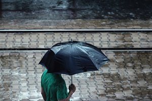 Man with a black umbrella