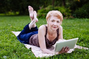 Woman in the park with tablet