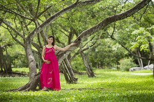 Asian pregnant woman in park