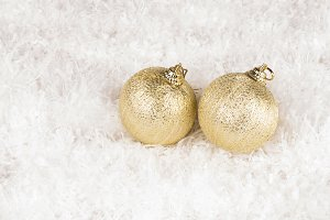 two golden baubles
