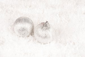 two silver baubles