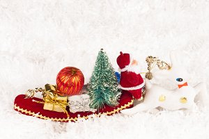 santa claus on sled with gifts