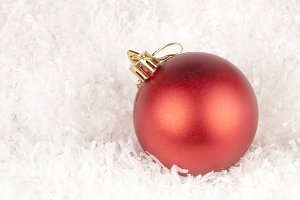 maroon bauble on white