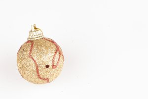 golden bauble on white