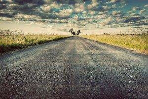 Empty straight asphalt road. Vintage