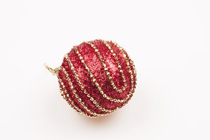 red bauble on white