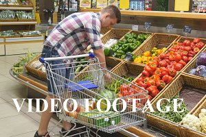 Boy buying peppers at store