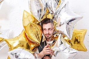 Man hiding in the balloons.