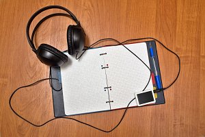 Headphones and player. Notebook