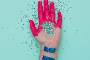 Painted hand with confetti