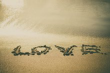 Love wrote on beach sand