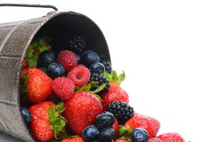 Pail with Berries Spilling Out