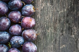 ripe plum on a wooden background
