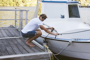 young man with the boat at the dock