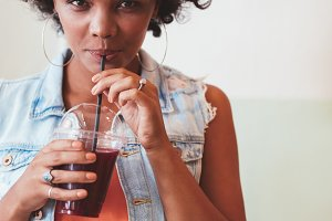 Young african woman drinking
